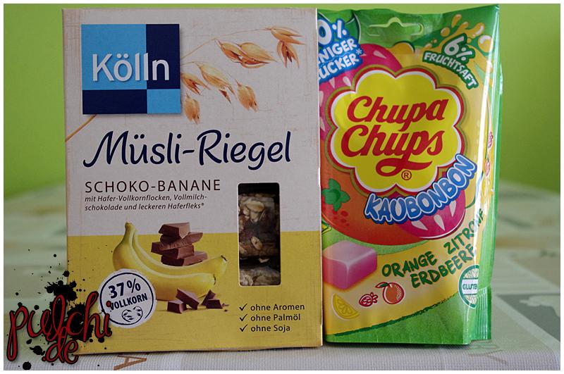 "Kölln Müsli-Riegel ""Schoko-Banane"" || Chupa Chups Kaubonbon ""Orange Zitrone Erdbeere"""